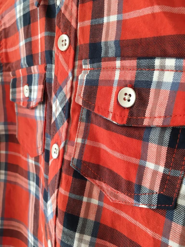 roco clothing review minoti orange checkered shirt lumberjack style boys pocket detail close up