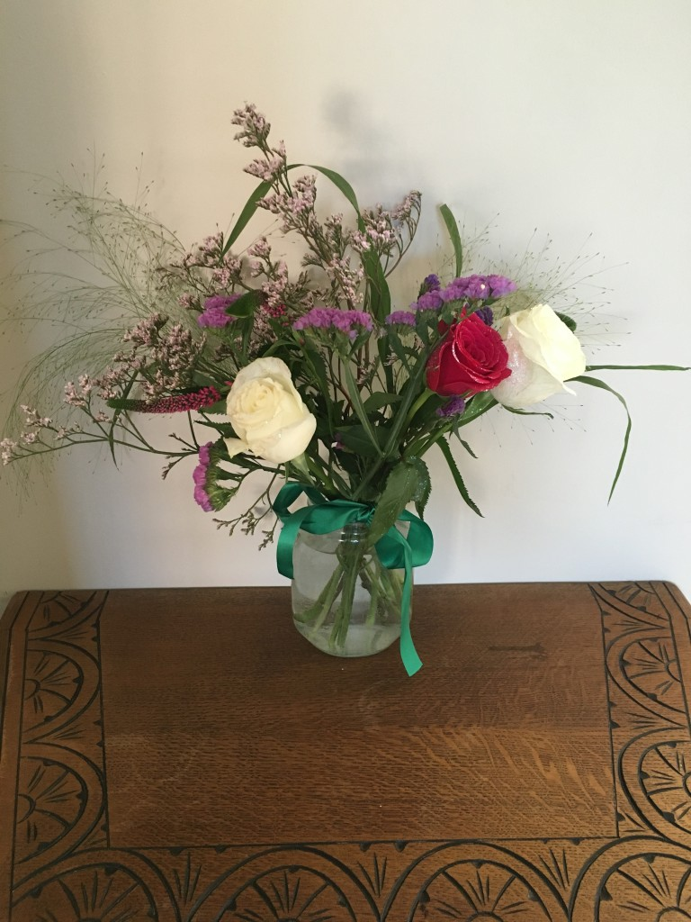 grace and bloom review flower subscription box delivered flowers seasonal displayed in hall way on vintage table