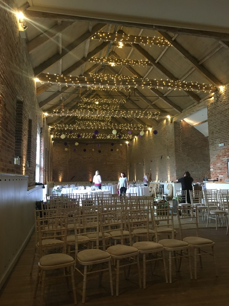 manor mews wedding set up own flowers rustic barn in norfolk wedding venue accommodation autumn october availability raising the rings blog fairy lights around the beams