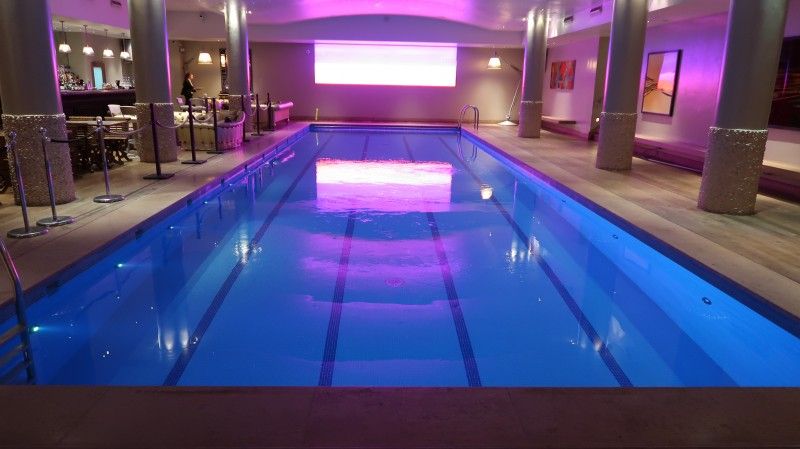 haymarket hotel underground swimming pool with cocktail bar and neon lights indoor pool london venue raising the rings lights by TENA event review feel fresh bladder weakness