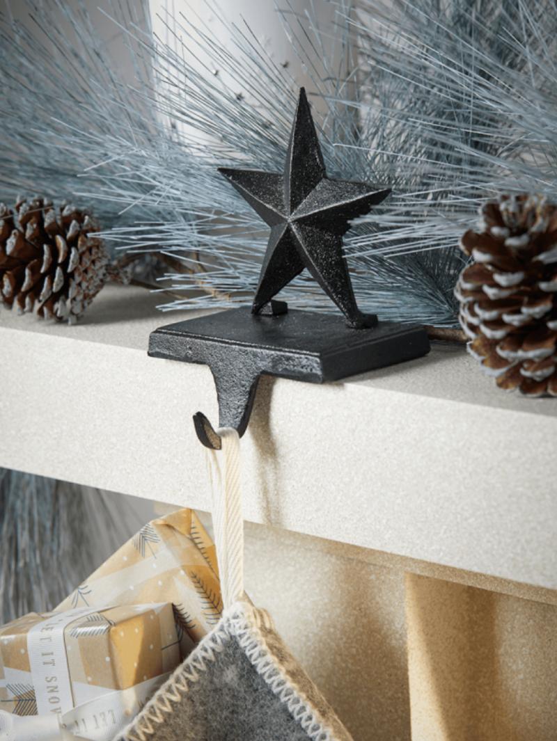 cox and cox mantelpiece stocking holder hanger star cast iron mantel decoration christmas inspiration
