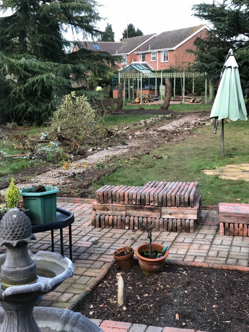 raising the rings sorting our garden before winter flower bed and path