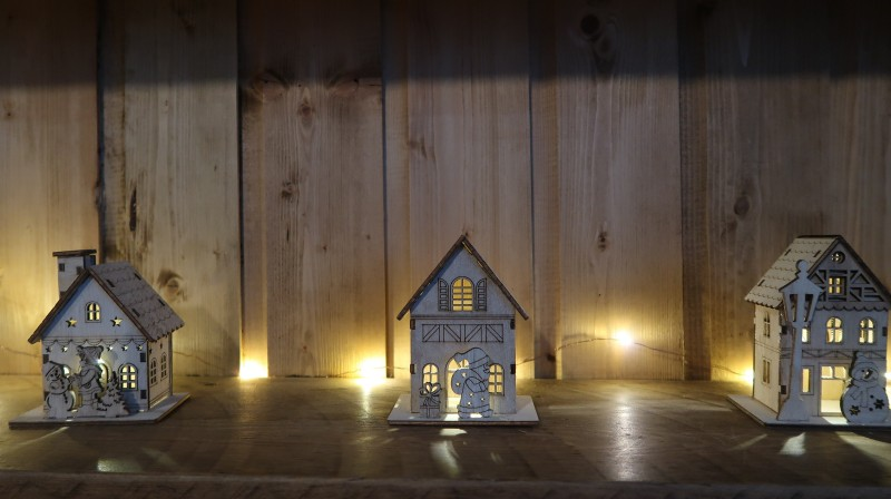 raising the rings christmas bonanza 30 days of giveaways win your christmas presents decorations small wooden houses with lights christmas scene snowman