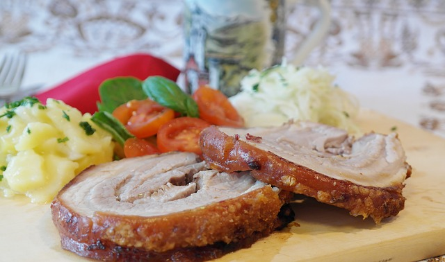 down the aisle Why Spit-Roasted Meat Is The Perfect Food Choice For Your Wedding Reception hog roast pig crackling serve as main meal