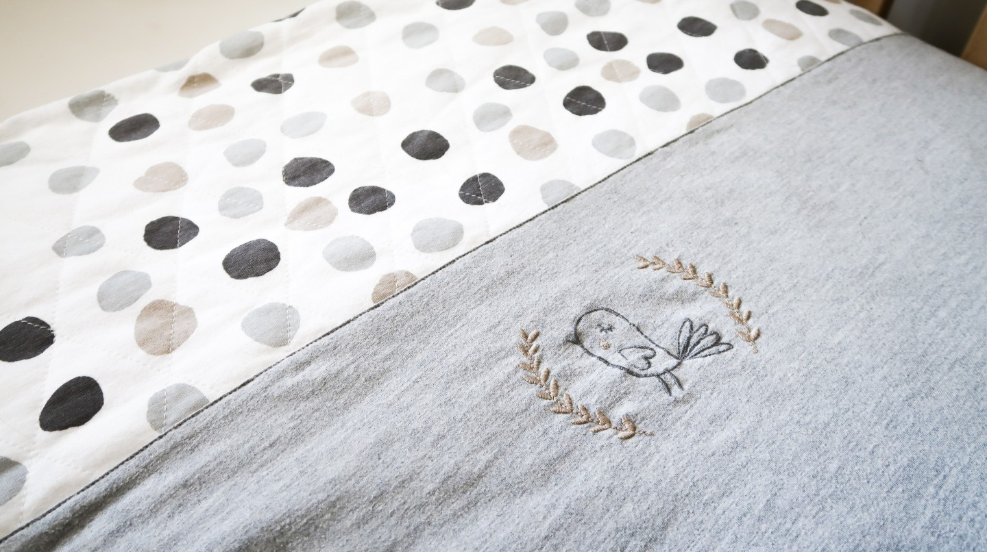 making our house a home baby number three nursery update the essential one little birdy range jersey quilt neutral grey
