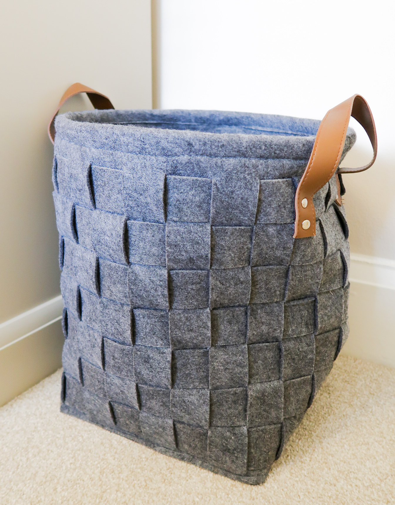 making our house a home baby number three nursery makeover room to grow felt weave basket leather brown handles toy storage solution